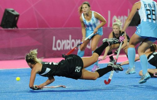 10 best field hockey pictures #4 Gemma Flynn of NZ flies thru the air and scores